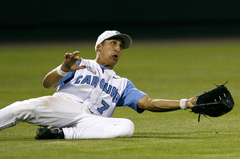 OMAHA, NE - JUNE 24:  Leftfielder Reid Fronk #7 of the North Carolina Tar Heels attempts to make a sliding catch in the outfield during their 9-3 loss to the Oregon State Beavers in Game 2 of the NCAA College World Series Championship at Rosenblatt Stadiu