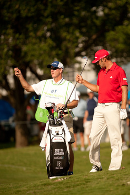 IRVING, TX - MAY 28: Dustin Johnson selects a club next to caddie Joe LaCava during the third round of the HP Byron Nelson Championship at TPC Four Seasons at Las Colinas on May 28, 2011 in Irving, Texas. (Photo by Darren Carroll/Getty Images)