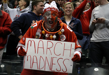 INDIANAPOLIS, IN - MARCH 13:  John 'Big Nut' Peters, fan of the Ohio State Buckeyes holds up a sign which reads 'March Madness' after they won 71-60 against the Penn State Nittany Lions during the championship game of the 2011 Big Ten Men's Basketball Tou