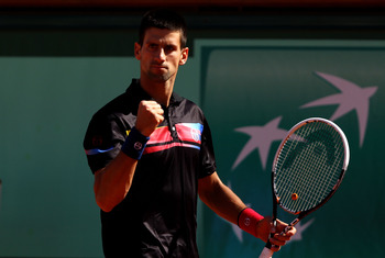 PARIS, FRANCE - MAY 25:  Novak Djokovic of Serbia celebrates a point during the men's singles round two match between Victor Hanescu of Romania and Novak Djokovic of Serbia on day four of the French Open at Roland Garros on May 25, 2011 in Paris, France.