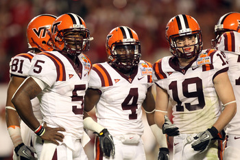 MIAMI, FL - JANUARY 03:  (L-R) Tyrod Taylor #5, David Wilson #4 and Danny Coale #19 of the Virginia Tech Hokies look towards the sideline against the Stanford Cardinal during the 2011 Discover Orange Bowl at Sun Life Stadium on January 3, 2011 in Miami, F