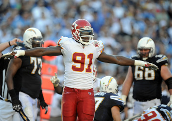SAN DIEGO, CA - DECEMBER 12:  Tamba Hali #91 of the Kansas City Chiefs celebrates a stop on third down against the San Diego Chargers at Qualcomm Stadium on December 12, 2010 in San Diego, California.  (Photo by Harry How/Getty Images)