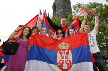 BERLIN - JUNE 18:  Football supporter of Serbia celebrate at Kurfuerstendamm after their team win the FIFA World Cup match between Germany and Serbia on June 18, 2010 in Berlin, Germany.  (Photo by Matthias Kern/Getty Images)