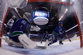 VANCOUVER, CANADA - MAY 24:  Kevin Bieksa #3 and goaltender Roberto Luongo #1 of the Vancouver Canucks defend their net in Game Five of the Western Conference Finals against the San Jose Sharks during the 2011 Stanley Cup Playoffs at Rogers Arena on May 2