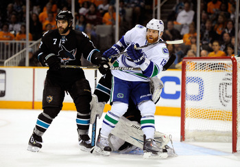SAN JOSE, CA - MAY 20:  Raffi Torres #13 of the Vancouver Canucks screens goaltender Antti Niemi #31 of the San Jose Sharks as Niclas Wallin #7 of the San Jose Sharks looks on in the second period in Game Three of the Western Conference Finals during the