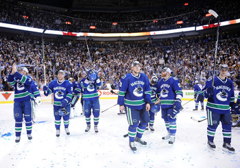 VANCOUVER, CANADA - MAY 24:  Henrik Sedin #33, Jannik Hansen #36, Maxim Lapierre #40, Alex Edler #23, Raffi Torres #13 and Mason Raymond #21 of the Vancouver Canucks acknowledge the fans after the  Canucks defeated the San Jose Sharks 3-2 in double-overti