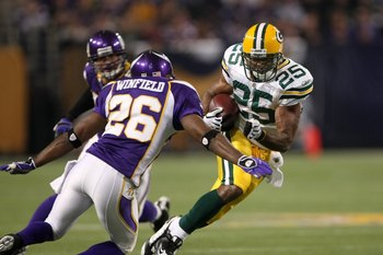 MINNEAPOLIS - NOVEMBER 09:  Running back Ryan Grant #25 of the Green Bay Packers carries the ball against cornerback Antoine Winfield #26 of the Minnesota Vikings on November 9, 2008 at the Metrodome in Mineapolis, Minnesota.  The Vikings won 28-27.  (Pho
