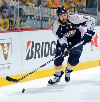 NASHVILLE, TN - MAY 03:  Shea Weber #6 of the Nashville Predators carries the puck behind the net and out of the reach of Henrk Sedin #33 of the Vancouver Canucks in Game Three of the Western Conference Semifinals during the 2011 NHL Stanley Cup Playoffs