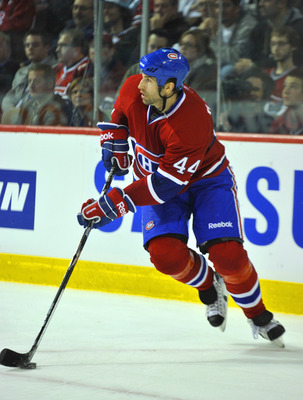 MONTREAL, CANADA - APRIL 18:  Roman Hamrlik #44 of the Montreal Canadiens turns up ice with the puck in Game Three of the Eastern Conference Quarterfinals against the Boston Bruins during the 2011 NHL Stanley Cup Playoffs at the Bell Centre on April 18, 2