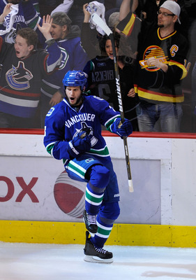 VANCOUVER, BC - MAY 15:  Kevin Bieksa #3 of the Vancouver Canucks celebrates his third period goal to tie the game at 2-2 against the San Jose Sharks in Game One of the Western Conference Finals during the 2011 Stanley Cup Playoffs at Rogers Arena on May
