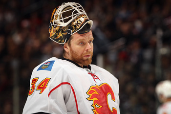 DENVER, CO - FEBRUARY 14:  Goalie Mikka Kiprusoff #34 of the Calgary Flames looks on during a break in the action against the Colorado Avalanche at the Pepsi Center on February 14, 2011 in Denver, Colorado. The Flames defeated the Avalanche 9-1.  (Photo b