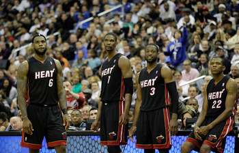 WASHINGTON, DC - MARCH 30:  LeBron James #6 of the Miami Heat stands with teammates Chris Bosh #1,  Dwyane Wade #3, and James Jones #22 against the Washington Wizards at the Verizon Center on March 30, 2011 in Washington, DC. NOTE TO USER: User expressly