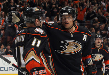 ANAHEIM, CA - APRIL 13:  Saku Koivu #11 and Teemu Selanne #8 of the Anaheim Ducks celebrate Selanne's third period goal against the Nashville Predators in Game One of the Western Conference Quarterfinals during the 2011 NHL Stanley Cup Playoffs at Honda C
