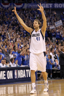DALLAS, TX - MAY 25:  Dirk Nowitzki #41 of the Dallas Mavericks reacts after making a three-pointer in the fourth quarter while taking on the Oklahoma City Thunder in Game Five of the Western Conference Finals during the 2011 NBA Playoffs at American Airl