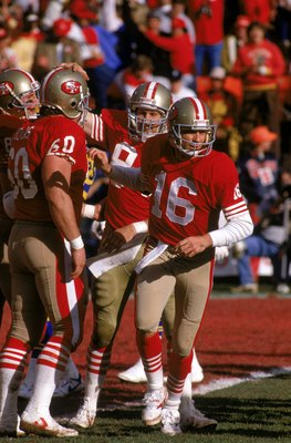 SAN FRANCISCO - JANUARY 14:  Quarterback Joe Montana #16, center Chuck Thomas 60 and tight end Brent Jones #84 of the San Francisco 49ers celebrates a touchdown by Jones during the NFC Championship game against the Los Angeles Rams at Candlestick Park on