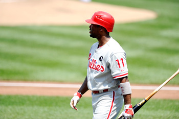 WASHINGTON, DC - MAY 30:  Jimmy Rollins #11 of the Philadelphia Phillies walks to the dugout after striking out against the Washington Nationals at Nationals Park on May 30, 2011 in Washington, DC.  (Photo by Greg Fiume/Getty Images)