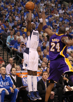 DALLAS, TX - MAY 08:  Guard Jason Terry #31 of the Dallas Mavericks takes a shot against Kobe Bryant #24 of the Los Angeles Lakers in Game Four of the Western Conference Semifinals during the 2011 NBA Playoffs on May 8, 2011 at American Airlines Center in
