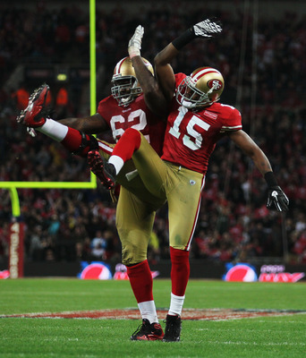 LONDON, ENGLAND - OCTOBER 31:  Michael Crabtree #15 of San Francisco 49ers celebrates with  Chilo Rachal #62 as he scores their second touchdown during the NFL International Series match between Denver Broncos and San Francisco 49ers at Wembley Stadium on
