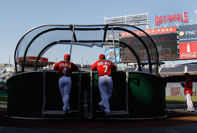 WASHINGTON, DC - APRIL 14: Hitting coach Rick Eckstein #4 and  Ivan Rodriguez #7 of the Washington Nationals watch batting practice before the start of their game against the Philadelphia Phillies at Nationals Park on April 14, 2011 in Washington, DC.  (P