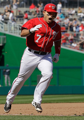WASHINGTON, DC - APRIL 17:  Ivan Rodriguez #7 of the Washington Nationals celebrates while rounding the bases after hitting a three run home run against the Milwaukee Brewers in the sixth inning during the first game of a doubleheader at Nationals Park on