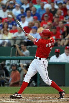 ARLINGTON, TX - MAY 07:  David Murphy #7 of the Texas Rangers hits a solo homerun against the New York Yankees at Rangers Ballpark in Arlington on May 7, 2011 in Arlington, Texas.  (Photo by Ronald Martinez/Getty Images)