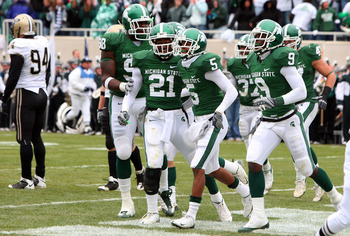 EAST LANSING, MI - NOVEMBER 08:  Johnny Adams #5 of the Michigan State Spartans celebrates his touchdown after an interception against the Purdue Boilermakers for a touchdown at Spartan Stadium on November 8, 2008 in East Lansing, Michigan.  (Photo by Jim