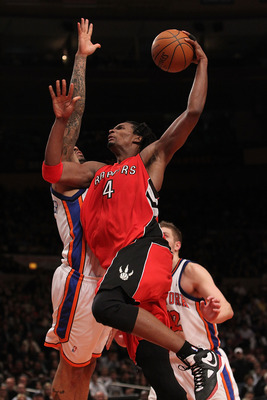 NEW YORK - JANUARY 28:  Chris Bosh #4 of the Toronto Raptors lays the ball up against the New York Knicks at Madison Square Garden on January 28, 2010 in New York, New York. NOTE TO USER: User expressly acknowledges and agrees that, by downloading and or