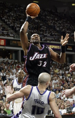 SACRAMENTO, CA - APRIL 19:  Karl Malone #32 of the Utah Jazz shoots over Mike Bibby #10 of the Sacramento Kings in Game one of the Western Conference Quarterfinals during the 2003 NBA Playoffs on April 19, 2003 at Arco Arena in Sacramento, California. (Ph