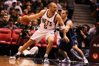 EAST RUTHERFORD, NJ - FEBRUARY 10:  Jason Kidd #5 of the New Jersey Nets leans into Jose Barea #11 of the Dallas Mavericks during their game at the Izod Center February 10, 2008 in East Rutherford, New Jersey.  NOTE TO USER: User expressly acknowledges an