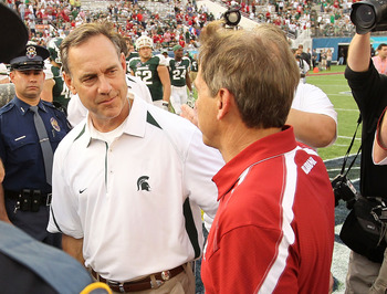 ORLANDO, FL - JANUARY 01:  Alabama Crimson Tide Head Coach Nick Saban greets Michigan State Spartans Head Coach Mark Dantonio after winning the Capitol One Bowl against at the Florida Citrus Bowl on January 1, 2011 in Orlando, Florida.  (Photo by Mike Ehr
