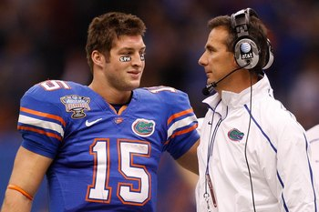 NEW ORLEANS - JANUARY 01:  Quarterback Tim Tebow #15  hugs head coach Urban Meyer of the Florida Gators after scoring a touchdown against the Cincinnati Bearcats during the Allstate Sugar Bowl at the Louisana Superdome on January 1, 2010 in New Orleans, L