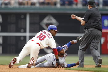 PHILADELPHIA, PA - MAY 22: Elvis Andrus #1 of the Texas Rangers tags out Ben Francisco #10 of the Philadelphia Phillies during a play at second base at Citizens Bank Park on May 22, 2011 in Philadelphia, Pennsylvania. The Rangers won 2-0. (Photo by Joe Ro