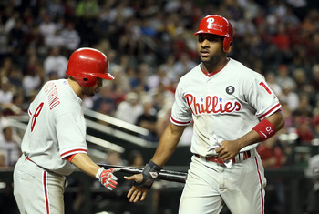 PHOENIX, AZ - APRIL 26:  Ben Francisco #10 of the Philadelphia Phillies high fives teammate Shane Victorino #8 after scoring a sixth inning run against the Arizona Diamondbacks during the Major League Baseball game at Chase Field on April 26, 2011 in Phoe