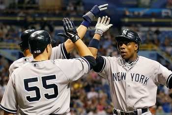 ST. PETERSBURG, FL - MAY 16:  Outfielder Curtis Granderson #14 of the New York Yankees is congratulated by Derek Jeter #2 and Russell Martin #55 after this fifth inning three run home run against the Tampa Bay Rays during the game at Tropicana Field on Ma