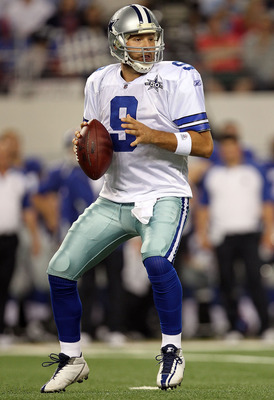 ARLINGTON, TX - OCTOBER 25:  Quarterback Tony Romo #9 of the Dallas Cowboys drops back to pass against the New York Giants in the first quarter at Cowboys Stadium on October 25, 2010 in Arlington, Texas.  (Photo by Ronald Martinez/Getty Images)