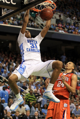 GREENSBORO, NC - MARCH 12:  John Henson #31 of the North Carolina Tar Heels dunks against Milton Jennings #24 of the Clemson Tigers during the second half in the semifinals of the 2011 ACC men's basketball tournament at the Greensboro Coliseum on March 12