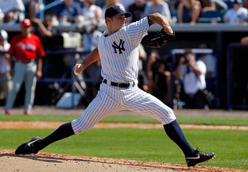 TAMPA, FL - FEBRUARY 26:  Pitcher David Robertson #30 of the New York Yankees pitches against the Philadelphia Phillies during a Grapefruit League Spring Training Game at George M. Steinbrenner Field on February 26, 2011 in Tampa, Florida.  (Photo by J. M