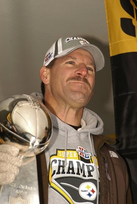 PITTSBURGH, PA - FEBRUARY 7:  Pittsburgh Steelers head coach Bill Cowher pauses before speaking to the crowd gathered at the end of  victory parade celebrating winning Super Bowl XL February 7, 2006 in downtown Pittsburgh Pennsylvania.  (Photo by Archie C