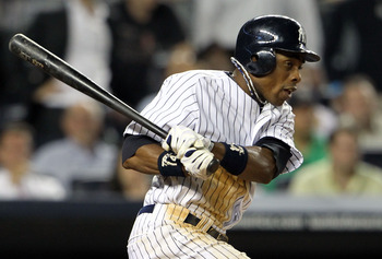 NEW YORK, NY - MAY 24:  Curtis Granderson #14 of the New York Yankees hits an RBI single in the ninth inning against the Toronto Blue Jays at Yankee Stadium on May 24, 2011 in the Bronx borough of New York City.  (Photo by Michael Heiman/Getty Images)