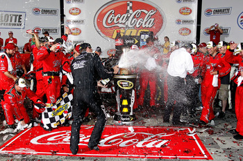 CONCORD, NC - MAY 29:  Kevin Harvick, driver of the #29 Budweiser Armed Forces Tribute Chevrolet, celebrates in Victory Lane after winning the NASCAR Sprint Cup Series Coca-Cola 600 at Charlotte Motor Speedway on May 29, 2011 in Concord, North Carolina.