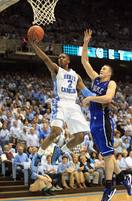 CHAPEL HILL, NC - MARCH 05:  Miles Plumlee #21 of the Duke Blue Devils tries to stop Leslie McDonald #2 of the North Carolina Tar Heels during their game at the Dean E. Smith Center on March 5, 2011 in Chapel Hill, North Carolina.  (Photo by Streeter Leck