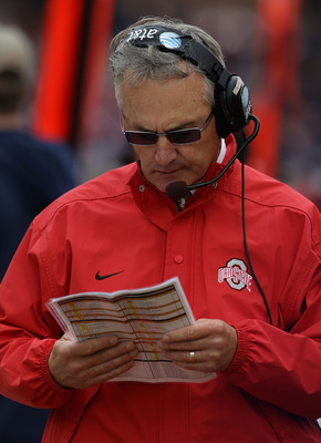 CHAMPAIGN, IL - OCTOBER 02: Head coach Jim Tressell of the Ohio State Buckeyes checks his play list during a game against the Illinois Fighting Illini at Memorial Stadium on October 2, 2010 in Champaign, Illinois. Ohio State defeated Illinois 24-13. (Phot