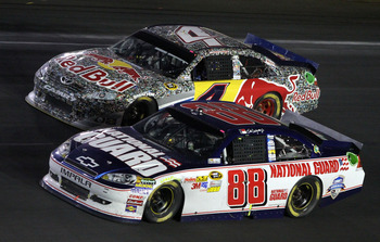 CONCORD, NC - MAY 29:  Dale Earnhardt Jr., driver of the #88 National Guard/Amp Energy Chevrolet, races side by side with Kasey Kahne, driver of the #4 Red Bull Toyota, during the NASCAR Sprint Cup Series Coca-Cola 600 at Charlotte Motor Speedway on May 2