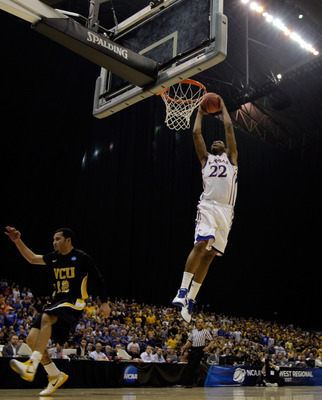 SAN ANTONIO, TX - MARCH 27:  Marcus Morris #22 of the Kansas Jayhawks dunks against Joey Rodriguez #12 of the Virginia Commonwealth Rams during the southwest regional final of the 2011 NCAA men's basketball tournament at the Alamodome on March 27, 2011 in