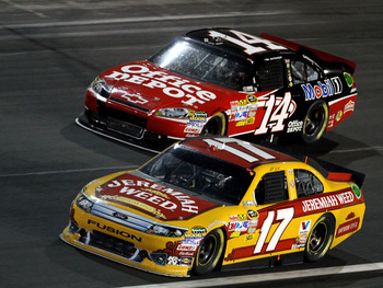 CONCORD, NC - MAY 29: Matt Kenseth, driver of the #17 Jeremiah Weed Ford races with Tony Stewart, driver of the #14 Office Depot / Mobil 1 Chevrolet during the NASCAR Sprint Cup Series Coca-Cola 600 at Charlotte Motor Speedway on May 29, 2011 in Concord,