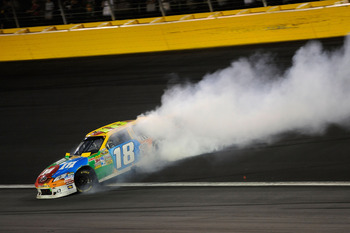 CONCORD, NC - MAY 29:  Kyle Busch, driver of the #18 M&M's Toyota, spins out after an incident in the NASCAR Sprint Cup Series Coca-Cola 600 at Charlotte Motor Speedway on May 29, 2011 in Concord, North Carolina.  (Photo by John Harrelson/Getty Images for