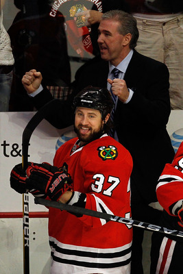 CHICAGO - MAY 23:  Adam Burish #37 and assistant coach Mike Haviland of the Chicago Blackhawks celebrate a late third period goal against the San Jose Sharks as the Blackhawks advance to the Stanley Cup after winning Game Four of the Western Conference Fi