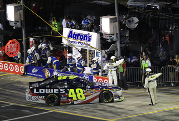 CONCORD, NC - MAY 29:  Jimmie Johnson drives the #48 Lowe's Summer Salute Chevrolet off pit road after an incident in the NASCAR Sprint Cup Series Coca-Cola 600 at Charlotte Motor Speedway on May 29, 2011 in Concord, North Carolina.  (Photo by Streeter Le