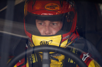 CHARLOTTE, NC - MAY 28:  Kurt Busch, driver of the #22 Shell/Pennzoil Dodge, sits in his car during practice for the NASCAR Sprint Cup Series Coca-Cola 600 at Charlotte Motor Speedway on May 28, 2011 in Charlotte, North Carolina.  (Photo by Chris Graythen