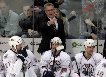 DENVER - JANUARY 16:  Head coach Craig MacTavish leads the Edmonton Oilers against the Colorado Avalanche during NHL action at the Pepsi Center on January 16, 2009 in Denver, Coloado. The Oilers defeated the Avalanche 3-2.  (Photo by Doug Pensinger/Getty